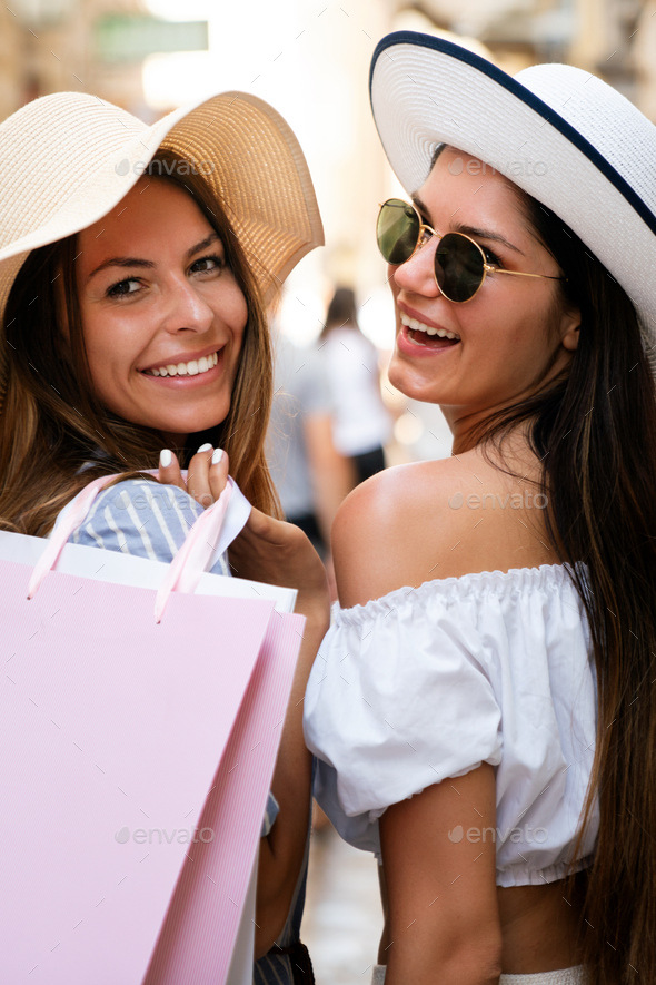 Sale and tourism, happy people concept. Beautiful women with shopping bag in the ctiy - Stock Photo - Images