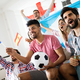 Cheerful and happy group of friends watching olympic games on tv - PhotoDune Item for Sale