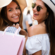 Sale and tourism, happy people concept. Beautiful women with shopping bag in the ctiy - PhotoDune Item for Sale