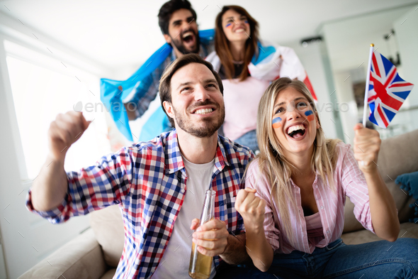 Group of friends having fun at home, watching game and enjoying together - Stock Photo - Images
