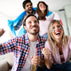 Group of friends having fun at home, watching game and enjoying together - PhotoDune Item for Sale