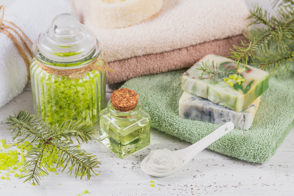 Natural cosmetic oil, sea salt, facial mask and natural handmade soap with coniferous extract - Stock Photo - Images