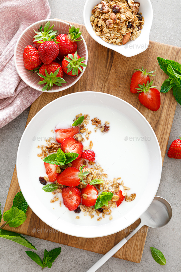 Strawberry granola with greek yogurt, nuts and fresh berries for breakfast, top view - Stock Photo - Images