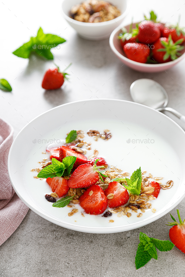 Strawberry granola with greek yogurt, nuts and fresh berries for breakfast - Stock Photo - Images