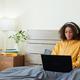 Serious Teenage Girl Using Laptop in Bed - PhotoDune Item for Sale