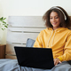 Content Girl in Headphones Typing on Laptop - PhotoDune Item for Sale