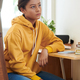 Mixed-race Girl Sitting at Desk - PhotoDune Item for Sale