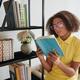 Teenage Girl Reading Book in Living Room - PhotoDune Item for Sale