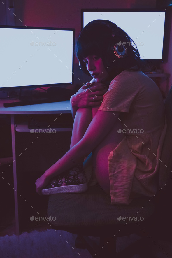 Young streamer woman working at night from home - Stock Photo - Images