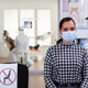 Portrait of woman in dental office looking on camera wearing face mask - PhotoDune Item for Sale