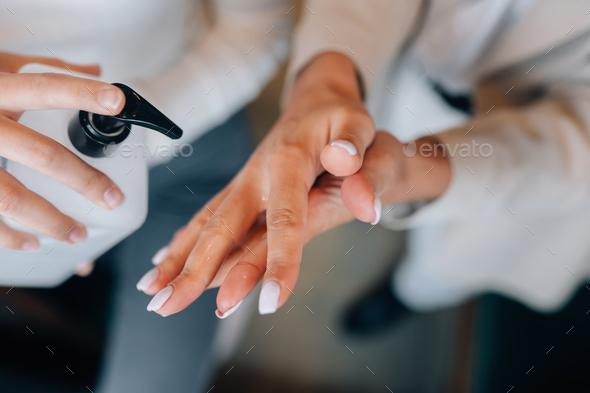 Female hands applying antibacterial liquid soap close up - Stock Photo - Images