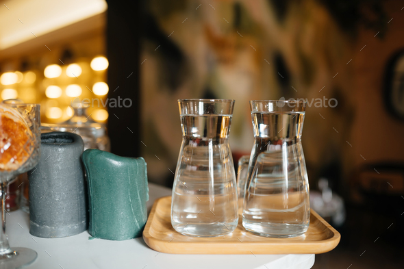 Four glass cups on the bar counter with serving accessories - Stock Photo - Images