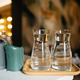 Four glass cups on the bar counter with serving accessories - PhotoDune Item for Sale