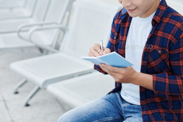 Man in Casual Shirt Making Notes - Stock Photo - Images