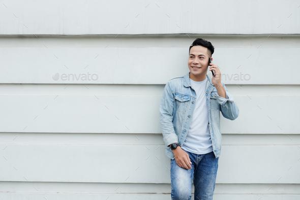 Asian man Having Phone Conversation - Stock Photo - Images