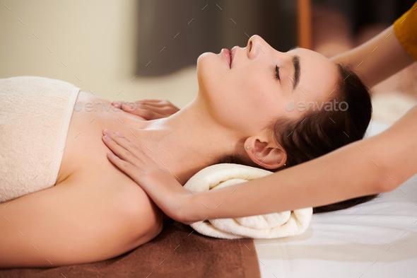 Therapist massaging woman - Stock Photo - Images