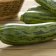 Fresh green spotted courgette on a cuttingboard close up - PhotoDune Item for Sale