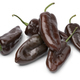 Whole fresh chocolate mini pointed bell peppers close up on white background - PhotoDune Item for Sale