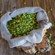 sack of split peas on wooden table - PhotoDune Item for Sale