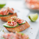 Toasts with smoked salmon and fresh cucumber served with lime shavings. - PhotoDune Item for Sale