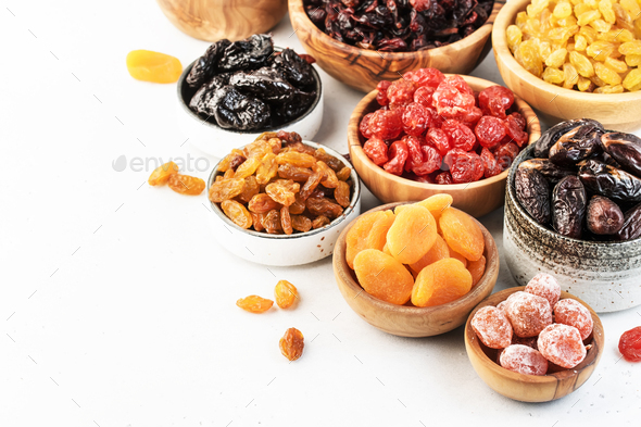 Healthy food snacks: natural dried fruits mix in bowls on white background - Stock Photo - Images