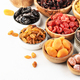 Healthy food snacks: natural dried fruits mix in bowls on white background - PhotoDune Item for Sale