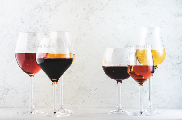 Wines assortment. Red, white, rose wine in wineglasses on gray background - Stock Photo - Images
