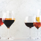Wines assortment. Red, white, rose wine in wineglasses on gray background - PhotoDune Item for Sale