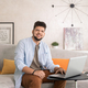 Young man using laptop while working in home office - PhotoDune Item for Sale