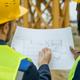 Two intercultural male builders discussing sketch - PhotoDune Item for Sale