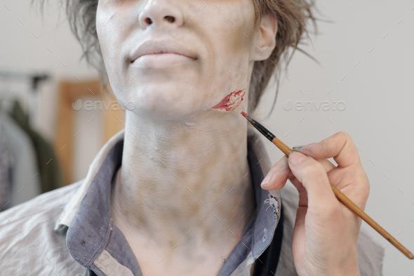 Paintbrush Making Zombie Visage Stock