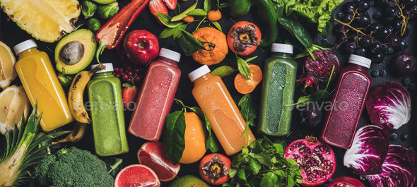 Fresh natural colorful organic juices over ingredients background, wide composition - Stock Photo - Images