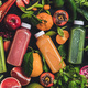 Fresh natural colorful organic juices over ingredients background, wide composition - PhotoDune Item for Sale