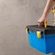 Man worker holding toolbox and tool belt near wall. Male hand and construction tools - PhotoDune Item for Sale