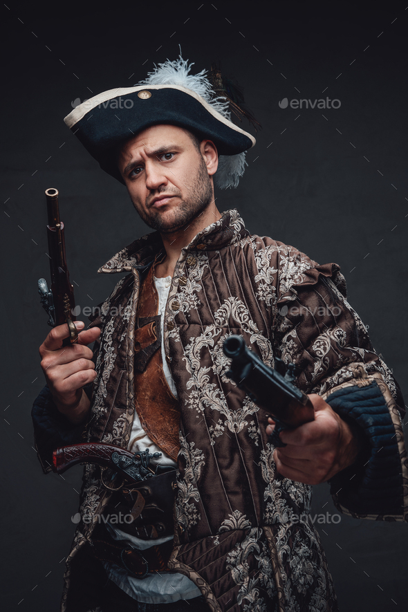 Pirate bandit with pistols against dark backgound - Stock Photo - Images