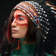 Sideview shot of woman with makeup and feather hat - PhotoDune Item for Sale