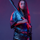Martial woman with sword against colorful background - PhotoDune Item for Sale
