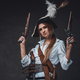 Woman corsair wearing shirt and hat with guns - PhotoDune Item for Sale