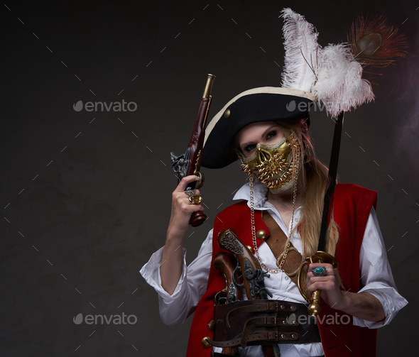Female model dressed in pirate suit with saber and gun - Stock Photo - Images