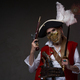Female model dressed in pirate suit with saber and gun - PhotoDune Item for Sale