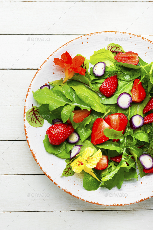 Summer salad with berries and herbs - Stock Photo - Images