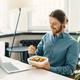 Sitisfied male employee eating vegetarian food at work - PhotoDune Item for Sale