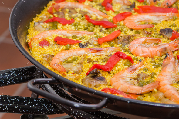 Traditional spanish paella cooked in a pan - Stock Photo - Images