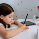 Girl studying at home with mask on table - PhotoDune Item for Sale