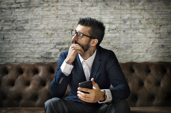 A businessman using a smartphone - Stock Photo - Images