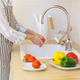 Faceless senior woman in apron preparing vegetables for salad while cooking in modern kitchen at - PhotoDune Item for Sale