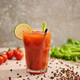 selective focus of bloody mary cocktail in glass with straw and lime near salt, pepper, tomatoes and - PhotoDune Item for Sale