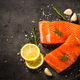 Salmon fish with ingredients at black table - PhotoDune Item for Sale