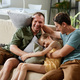 Gay family with child sitting at home - PhotoDune Item for Sale