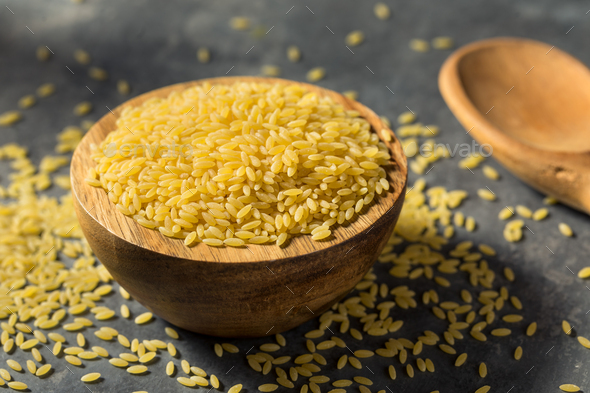 Raw Organic Dry Orzo Pasta - Stock Photo - Images